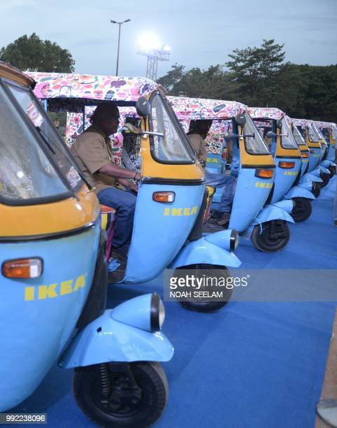 Indian auto rickshaw drivers sit in their vehicles painted in Ikea colours at a promotional event for the new Ikea furniture store in Hyderabad on...