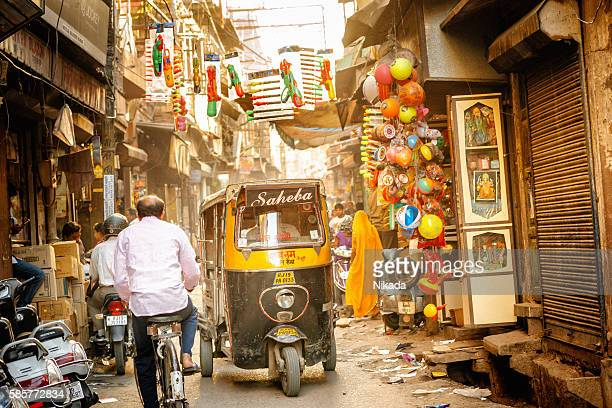 indian auto rickshaw in the narrow streets of jodhpur - rickshaw stock photos and pictures