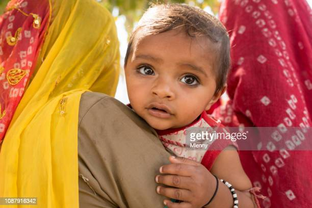 Indian Baby Girl on Mother's Arm Portrait India