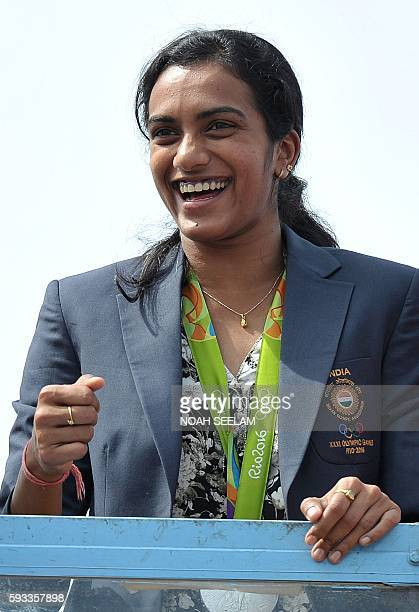 Indian badminton player and Olympic silver medalist PV Sindhu takes part in a parade after arriving home from the Rio Olympics in Hyderabad on August...