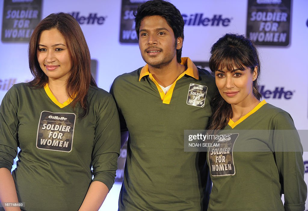 Indian badminton player Jwala Gutta (L), actor Sundeep Kishan (C), and actress Chitrangada Singh (R) pose at a 'Soldier for Women' promotional campaign in Hyderabad on April 29, 2013. The campaign was organised to encourage Indian men to treat women with dignity and respect, following a spate of of sex attacks that have made global headlines. Attacks on women in India have been in the spotlight since December 16, when a student was brutally attacked and raped by six men on a moving bus in New Delhi. She died two weeks later of her injuries. AFP PHOTO/Noah SEELAM