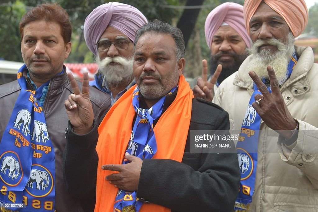 Indian Bahujan Samaj Party candidate for the Punjab Legislative Assembly Tarsem Singh Bhola gestures to supporters as he arrives to file his...