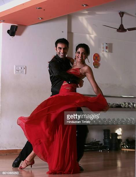 Indian ballroom dancer and Bollywood choreographer Sandeep Soparkar and wife Jesse Randhawa in dancing poses