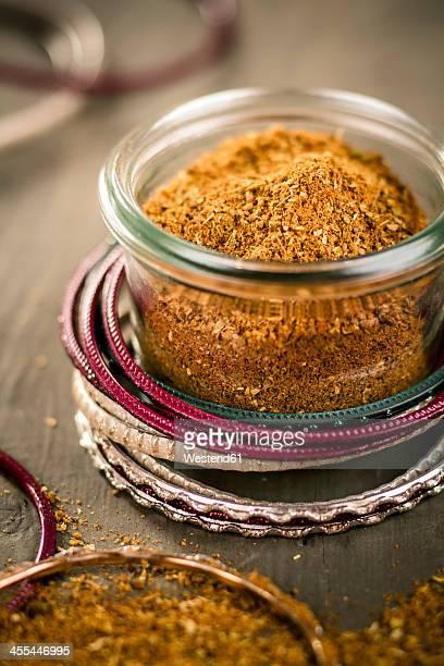 indian bangles with jar of garam masala, close up - garam masala stock photos and pictures