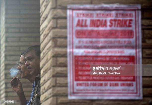 Indian bank employees gather as they take part in a strike at a branch of The State Bank of India in New Delhi on August 5, 2011. Some one million...