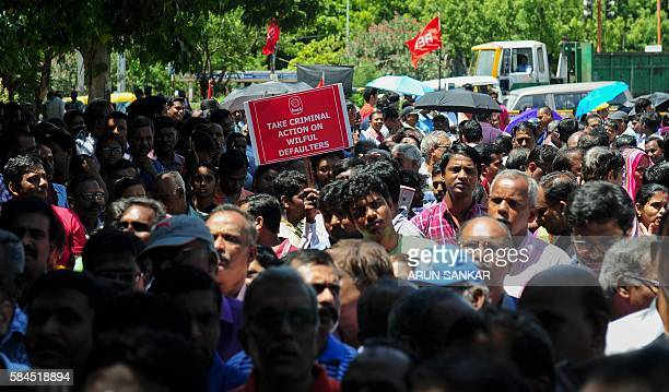 Indian banking staff rally against the central government's banking policies during a strike in Chennai on July 29 2016 Banking operations across the...