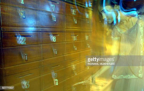 Indian bar dancer Mala puts her tip into a numbered box at a suburban bar cum restaurant in Bombay 06 May 2005 The western state of Maharashtra has...
