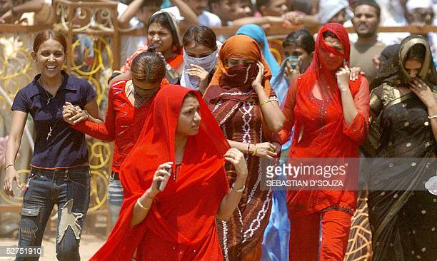 Indian bar girls shout slogans as they take part in a demonstration in Bombay 03 May 2005 held to protest the government's decision to close all...