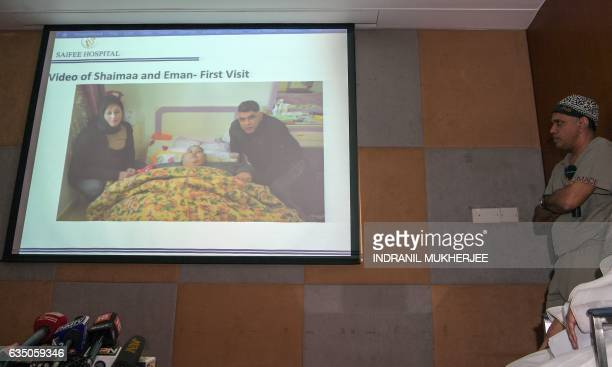 Indian bariatric surgeon Muffazal Lakdawala looks on as images of Egyptian national Eman Ahmed Abd El Aty who weighs around 500 kilograms are shown...