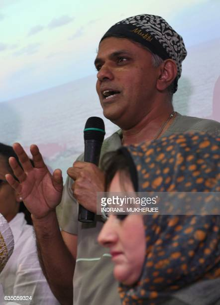 Indian bariatric surgeon Muffazal Lakdawala speaks at a press conference next to Egyptian national Shaima Selim on the case of his patient and...