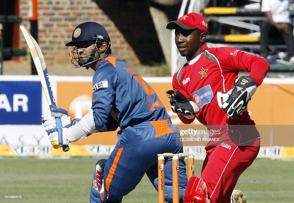 Indian batman Dinesh Karthik (L) waits to see if he is safe to make a run as Zimbabwean wicket keeper Tatenda Taibu awaits an opportunity for a run out at Harare Sports Club on June 3, 2010 in the fourth match of the Micromax Cup Triangular One-Day series which includes Sri Lanka. AFP PHOTO / Desmond Kwande