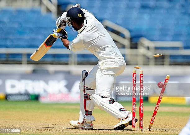 Indian batsman Abhinav Mukund is bowled out by West Indies bowler Ravi Rampaul during the first day of the first test match between West Indies and...