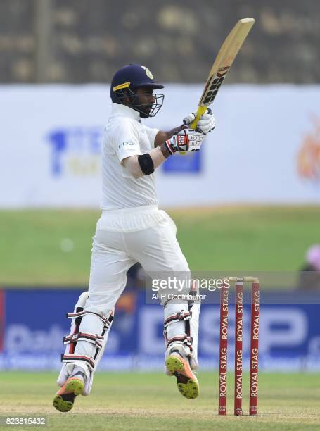 Indian batsman Abhinav Mukund plays a shot during the third day of the first Test match between Sri Lanka and India at Galle International Cricket...