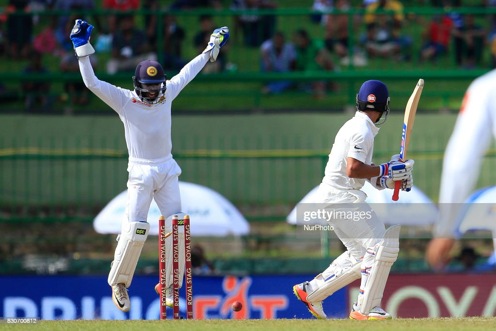Indian batsman Ajinkya Rahane(R) gets bowled out during the 1st Day's play in the 3rd Test match between Sri Lanka and India at the Pallekele International cricket stadium, Kandy, Sri Lanka on Saturday 12 August 2017.