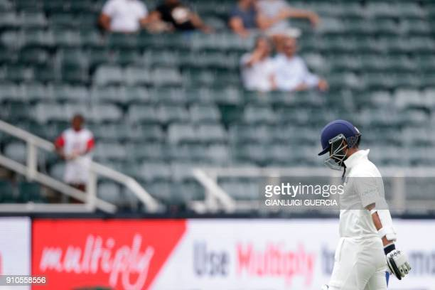 Indian batsman Ajinkya Rahane leaves the field after being dismissed during the third day of the third test match between South Africa and India at...