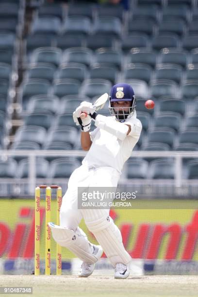 Indian batsman Ajinkya Rahane plays a shot during the third day of the third test match between South Africa and India at Wanderers cricket ground on...