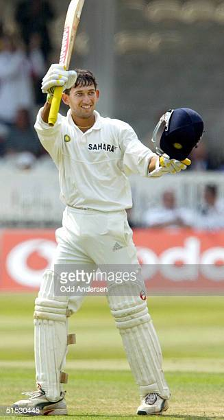 Indian batsman Ajit Agarkar celebrates his maiden test century during testmatch against England at Lord's cricket ground in London 29 July 2002...