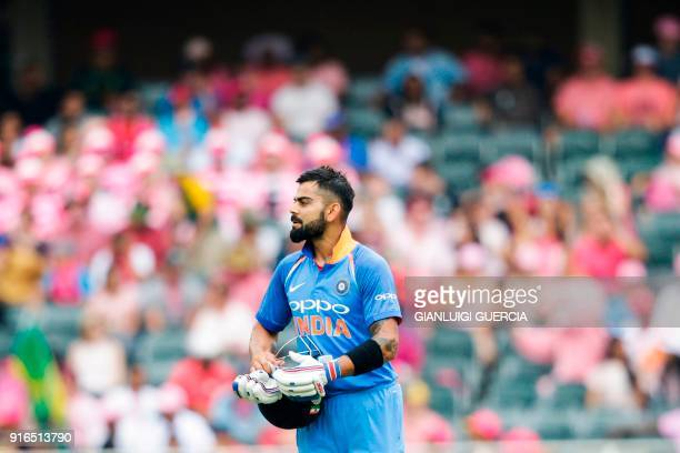 Indian batsman and Captain Virat Kohli communicates with his bench during the fourth One Day International cricket match between South Africa and...