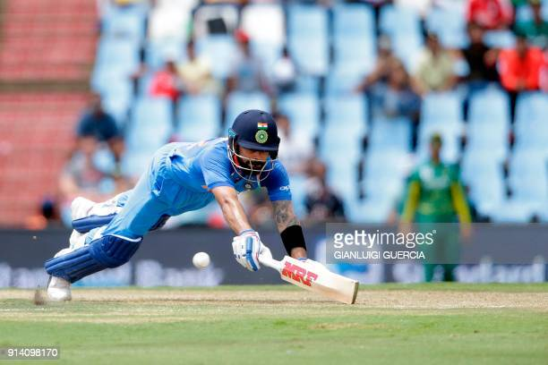 Indian batsman and Captain Virat Kohli dives as he avoids a run out during the second day of the One Day International cricket match between South...