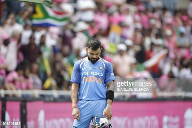 Indian batsman and Captain Virat Kohli leaves the field after being dismissed by South African bowler Cris Morris during the fourth One Day...