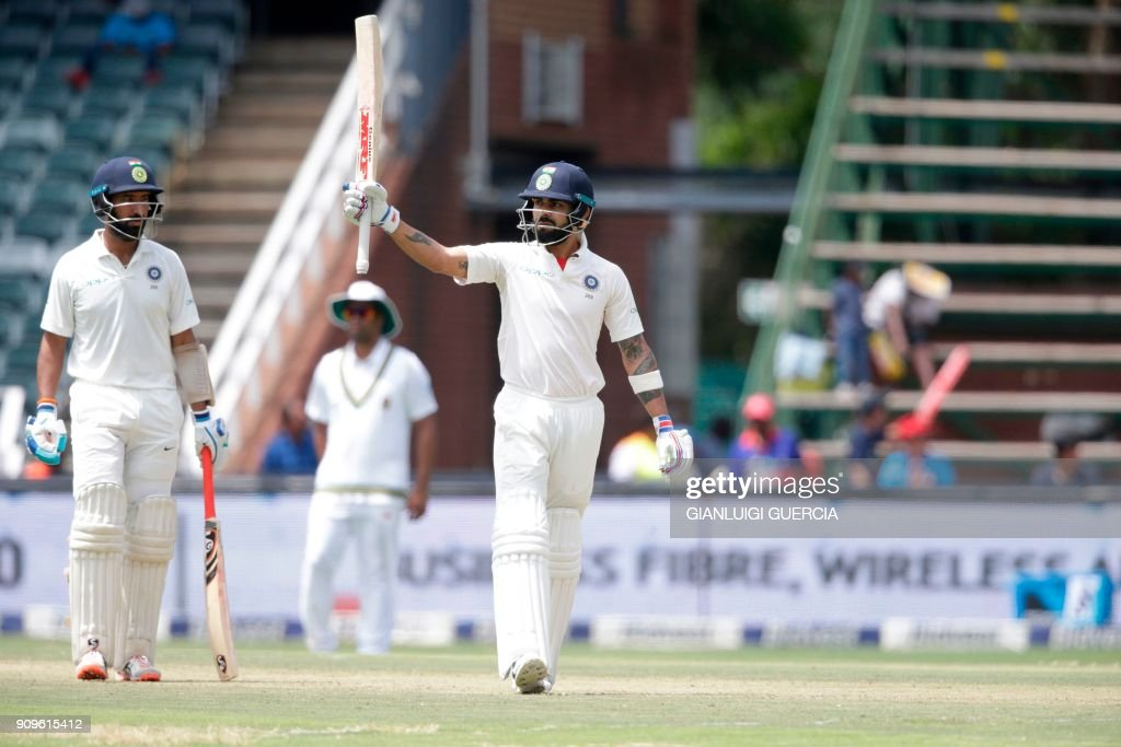 Indian batsman and Captain Virat Kohli raises his bat as he celebrates scoring a half century (50 runs) during the first day of the third cricket Test match between South Africa and India at the Wanderers cricket ground n Johannesburg, South Africa on January 24, 2018 . /