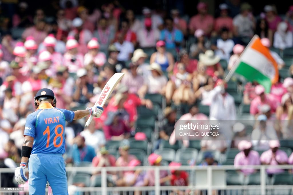 Indian batsman and Captain Virat Kohli raises his bat as he celebrates scoring half century (50 runs) during the fourth One Day International cricket match between South Africa and India at Wanderers cricket ground on February 10, 2018 in Johannesburg, South Africa. /