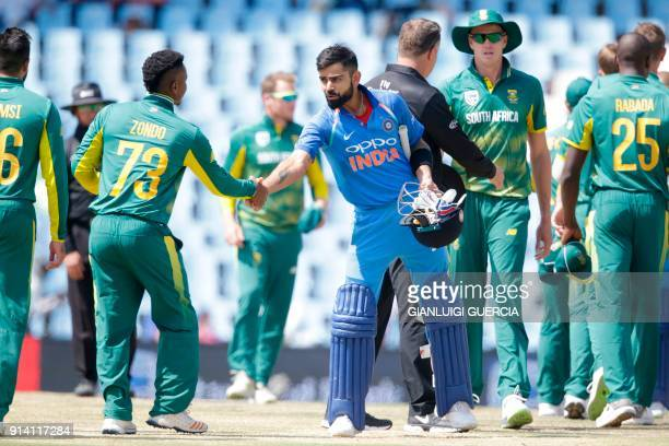 Indian batsman and Captain Virat Kohli shakes hand with South African batsman Khaya Zondo after winning the match during the second day of the One...
