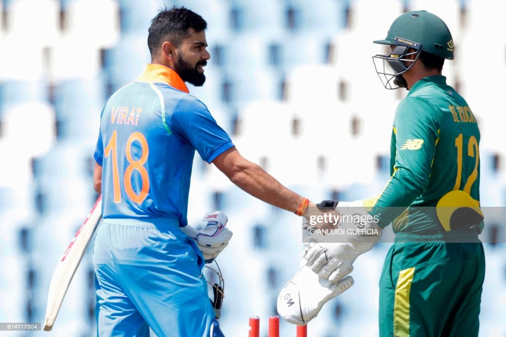 Indian batsman and Captain Virat Kohli (L) shakes hand with South African wicket keeper Quinton de Kock (R) after winning the match during the second day of the One Day International (ODI) cricket match between South Africa and India at the Centurion cricket ground on February 4, 2018 in Centurion, South Africa. /