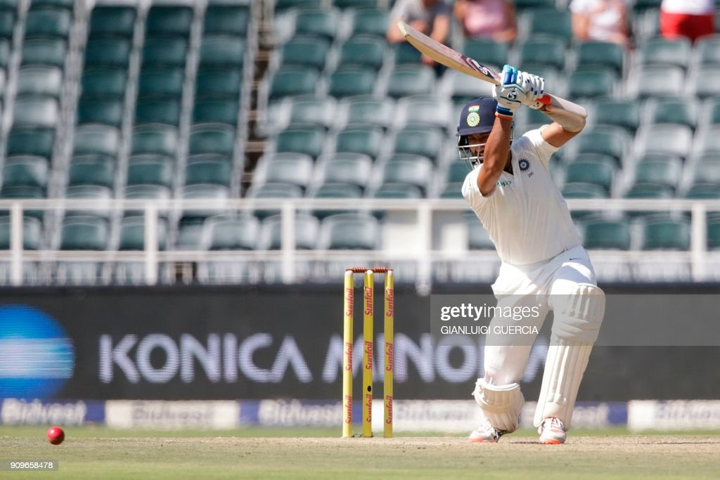 Indian batsman Cheteshwar Pujara plays a shot during the first day of the third test match between South Africa and India at Wanderers cricket ground on January 24, 2018 in Johannesburg. /
