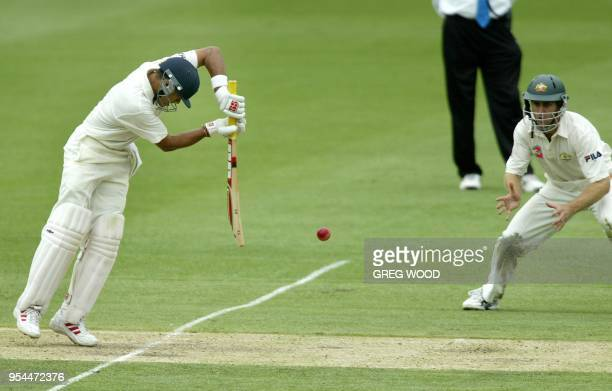 Indian batsman Chopra Akash plays a shot watched by close in fieldsman Australia's Simon Katich on day four of the first cricket Test at the Gabba...