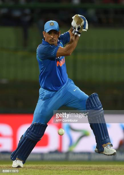Indian batsman MS Dhoni plays a shot during the second One Day International cricket match between Sri Lanka and India at the Pallekele International...