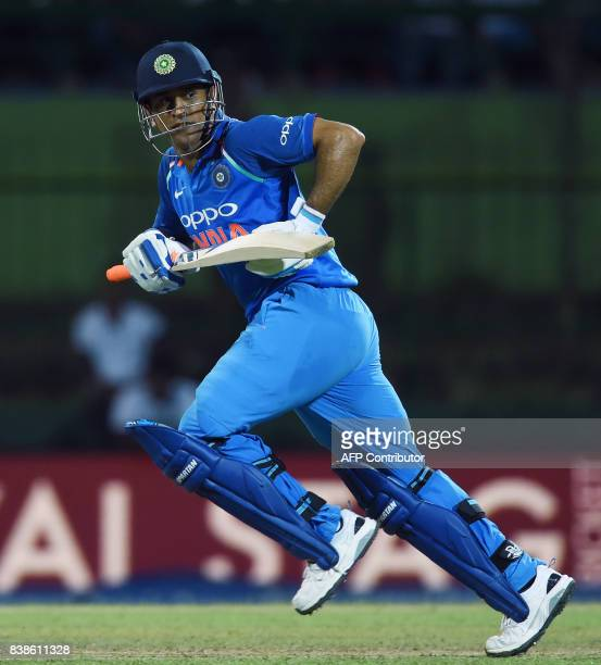 Indian batsman MS Dhoni runs between the wickets during the second One Day International cricket match between Sri Lanka and India at the Pallekele...