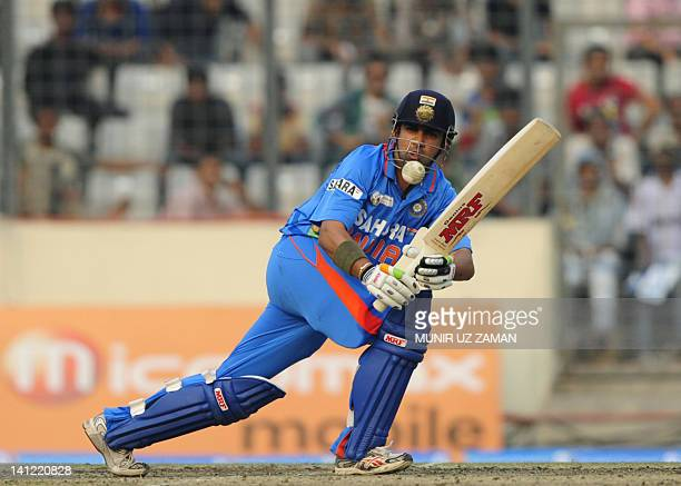 Indian batsman Gautam Gambhir plays a shot during the one day international Asia Cup cricket match between India and Sri Lanka at the ShereBangla...