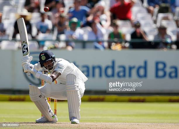 Indian batsman Hardik Pandya ducks to avoid a bouncer delivered by South Africa's Kagiso Rabada during the second day of the first Test cricket match...