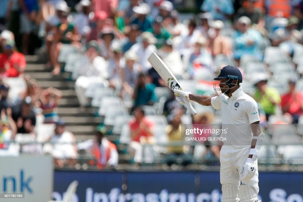 Indian batsman Hardik Pandya raises his bat as he celebrates scoring half century (50 runs) during the second day of the first Test cricket match between South Africa and India at Newlands cricket ground on January 6, 2018 in Cape Town, South Africa. /