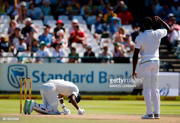 Indian batsman Hardik Pandya reacts after being hit by a ball delivered by South Africa's Kagiso Rabada during the second day of the first Test...