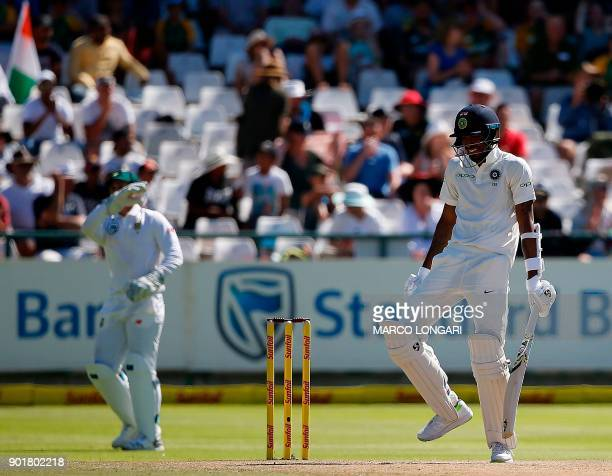 Indian batsman Hardik Pandya reacts after ducking to avoid a bouncer delivered by South Africa's Kagiso Rabada during the second day of the first...