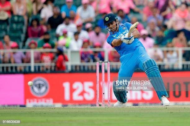 Indian batsman Mahendra Dhoni plays a shot during the fourth One Day International cricket match between South Africa and India at Wanderers cricket...