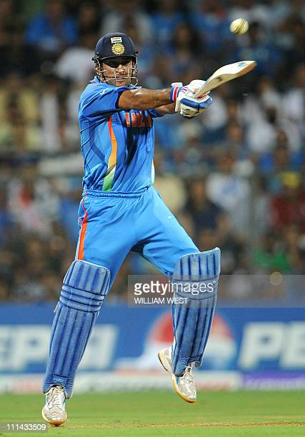 Indian batsman Mahendra Singh Dhoni hits a cracking shot from the Sri Lankan bowling during the ICC Cricket World Cup 2011 final played at The...