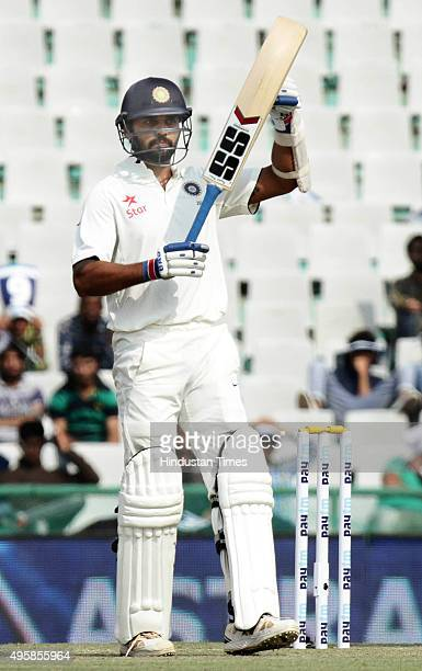 Indian batsman Maurali Vijay celebrates after making fifty against South Africa during the test match been played at PCA Stadium on November 5 2015...
