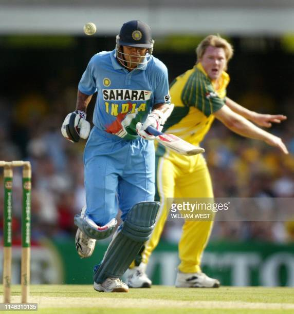 Indian batsman Rahul Dravid attempts to makes his ground and is narrowly missed by the ball thrown by Australian paceman Brad Williams during their...