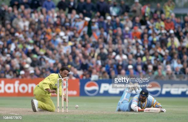 Indian batsman Robin Singh dives and makes his ground as Pakistan's Shoaib Akhtar attempts to run him out during the World Cup Super Six match...