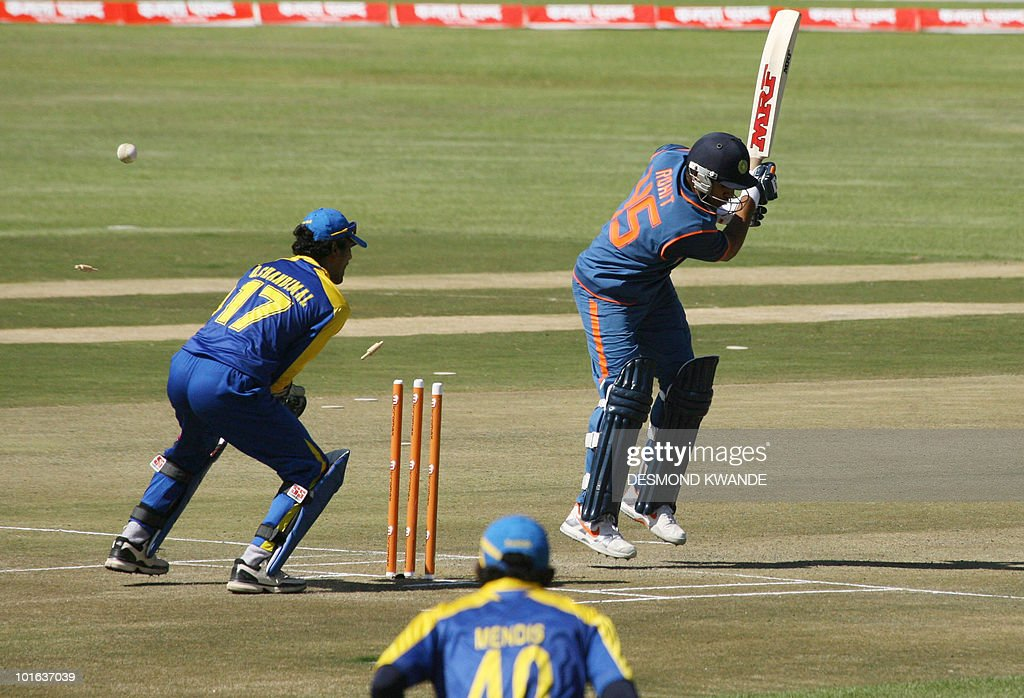 Indian batsman Rohit Sharma (R) loses a wicket off Sri Lanki bowler Randiv Kaluhalamulla at the Harare Sports Club on June 5, 2010 in the fifth match of the Micromax Cup Triangular one-day series in the Zimbabwean capital. AFP PHOTO / Desmond Kwande