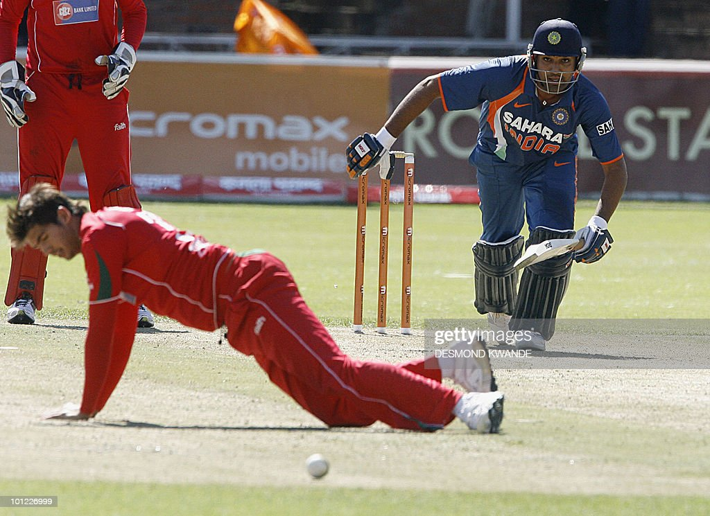 Indian Batsman Rohit Sharma makes a run as Zimbabwe's fielder Craig Ervine fails to stop the ball in the first match of the Micromax Cup Triangular One-Day International series on May 28, 2010 at Queens Sports club in Bulawayo. India finished at 285 for 5 after 50 overs. AFP PHOTO / Desmond Kwande
