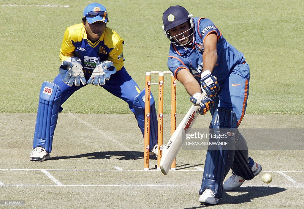 Indian batsman Rohit Sharma takes a shot as Sri Lanki wicketkeeper Dinesh Chandimal watches him at the Harare Sports Club on June 5, 2010 in the fifth match of the Micromax Cup Triangular one-day series in the Zimbabwean capital. AFP PHOTO / Desmond Kwande