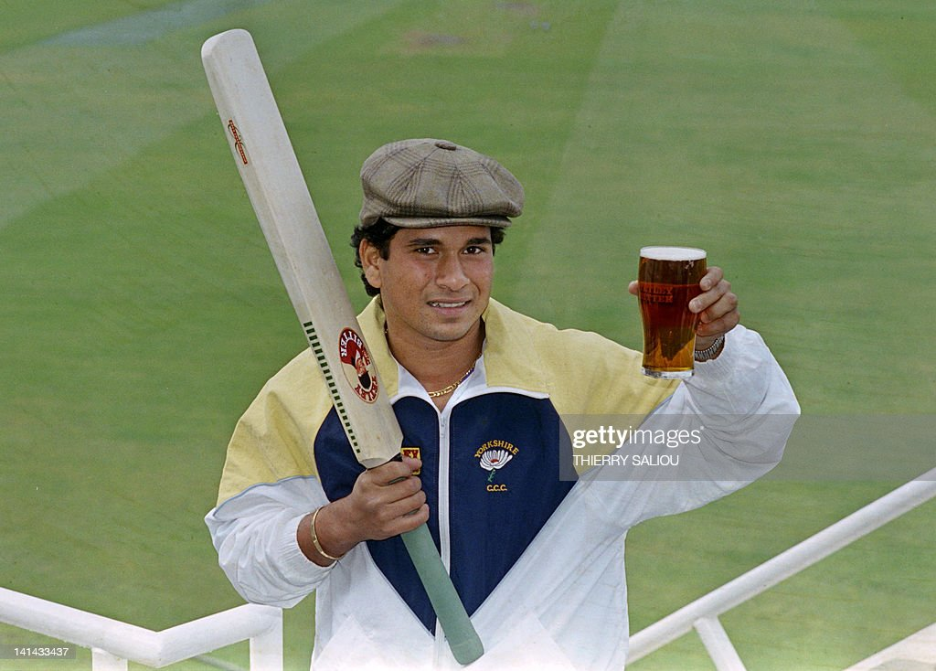 Indian batsman Sachin Tendulkar arrives at the Oval in London with a pint of English beer, on April 28, 1992, before making his debut for the Yorshire team on April 30.