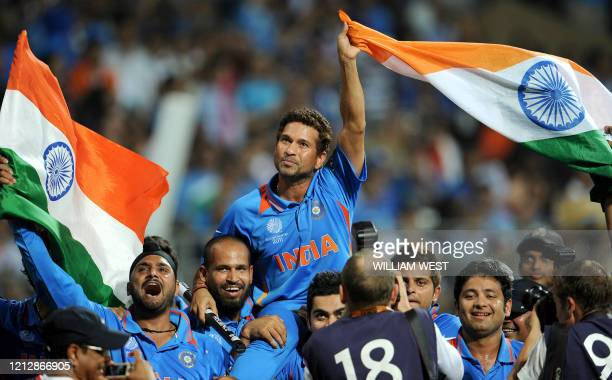 Indian batsman Sachin Tendulkar is carried on his teammates shoulders after India defeated Sri Lanka in the ICC Cricket World Cup 2011 final played...