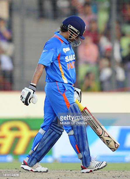 Indian batsman Sachin Tendulkar leaves the field after being dismissed during the one day international Asia Cup cricket match between India and...
