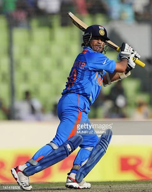 Indian batsman Sachin Tendulkar plays a shot during the one day international Asia Cup cricket match between India and Bangladesh at the...