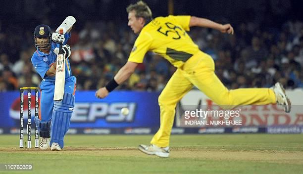 Indian batsman Sachin Tendulkar plays a shot past Australian bowler Brett Lee during the quarterfinal match of The ICC Cricket World Cup 2011 between...